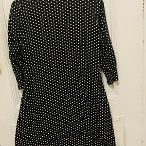 size Small black with white polka dots.